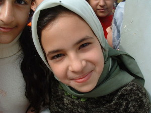 "Iraqi girl in 2003. Image Source: ""Iraqi girl smiles"" by Christiaan Briggs -"