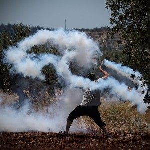"""Tear gas grenade returned to soldiers using sling"" by Yaron Ben-haim"