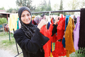 Knitting a brighter future for Syrian refugees in Lebanon  A woman from Homs, Syria, now a refugee in Lebanon, shows off knitted woolen clothes that she's learnt how to make, with support from the International Rescue Committee and UK aid.   As well as training women to make fishing nets, for which there is a local market in northern Lebanon, the International Rescue Committee is also running a project helping women to learn to knit clothes. The clothes can then either be used by the refugees themselves (many refugees were able to bring very few clothes with them from Syria) or they can be sold at local Lebanese markets like this one.   The UK has committed over £600 million to help those affected by the conflict in Syria - our largest ever response to a humanitarian crisis. This funding is providing support including food, medical care and relief items for over a million people - people who have been affected by the fighting but are still inside Syria and those who have fled the country and become refugees in neighbouring Lebanon, Jordan, Turkey and Iraq.   Picture: Russell Watkins/DFID