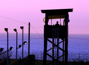 GUANTANAMO BAY, Cuba – Spc. Emely Nieves from the Puerto Rico Army National Guard guards her post over the Joint Task Force Guantanamo detention facility at sunrise, Jan. 7. JTF Guantanamo provides safe, humane, legal and transparent care and custody of detainees, including those convicted by military commission and those ordered released by a court. (JTF Guantanamo photo by U.S. Air Force Senior Airman Gino Reyes)