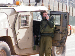 IDF soldier outside of West Bank Image Source: Vadim Lavrusik, Flickr, Creative Commons
