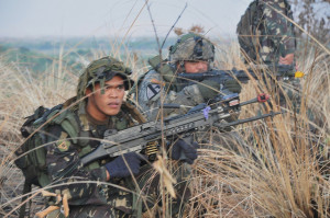 "Armed Forces of the Philippines and U.S. soldiers, designated as Combined Task Force 50-100th, on their second consecutive day conduct an early morning raid, April 18, to capture Hilltop 142, which was infested with ""enemy"" role-players. This is one of many scenarios AFP and U.S. forces train to during Exercise Balikatan 2012. The exercise is an annual bilateral event, which benefits both militaries in continuing to build upon their high level of cooperation and interoperability. Balikatan 2012 Photo by Sgt. 1st Class Peter Eustaquio Date Taken:04.18.2012 Location:FORT MAGSAYSAY, PH Read more: www.dvidshub.net/image/561909/philippine-us-soldiers-cond..."