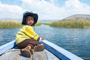 Image Source: Christopher Crouzet, Flickr, Creative Commons Uro Boy A local Uro boy sitting in the front of a boat on the way back from the famous floating islands nearby Puno, Peru.