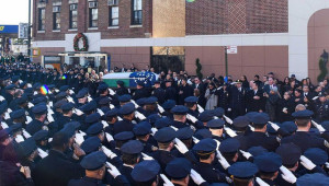 Image Source: Tiocfaidh ár lá 1916, Flickr, Creative Commons Police officers give a farewell salute to NYPD Officer Rafael Ramos as an honor guard carries his flag-draped coffin from Christ Tabernacle Church in Queens on Saturday, Dec. 27, 2014.