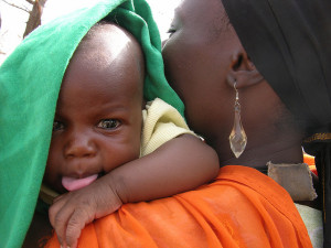 Image Source: Stephanie ZIto, Flickr, Creative Commons Baby Nadir Life in the desert- Mother Munira and first born baby boy Nadir, West Darfur Sudan.
