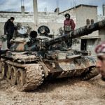 Image Source: Freedom House, Flickr, Creative Commons Feb. 23, 2012. A Free Syrian Army member prepares to fight with a tank whose crew defected from government forces in al-Qsair