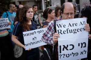 Image Source: Sasha Kimel, Flickr, Creative Commons Refugees  Anti-Racism Protest
