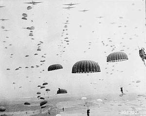 Parachutes open overhead as waves of paratroops land in Holland during operations by the 1st Allied Airborne Army., 09/1944