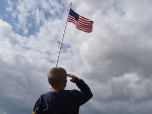 Image Source: Jeff Turner, Flickr, Creative Commons Child Saluting American Flag