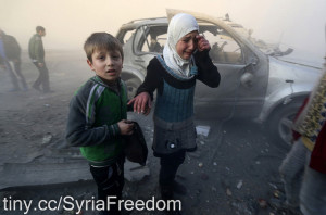 Image Source: Freedom House Flickr, Creative Commons A girl cries near a damaged car at a site hit by what activists said were barrel bombs dropped by government forces in Aleppo's Dahret Awwad neighborhood January 29, 2014.