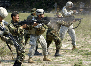 Image Source: U.S. Army Soldiers and the El Salvador Army Parachute Battalion fire Minimi weapon during a small unit familiarization program platoon exchange in San Salvador, El Salvador, May 1, 2006. The Minimi is the Belgian version of the M249 Squad Assault Weapon. DoD photo by Kaye Richey, U.S. Army. This photo appeared on www.army.mil.