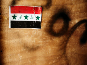 Image Source: Jayel Aheram, Flickr, Creative Commons Iraqi Flag Sticker (or 5000th Image)  A sticker on a cabinet made from scraps of wood and discarded water palettes.