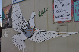 "Image Source: Neil Ward, Flickr, Creative Commons Banksy dove Photos from the Palestinian side of the ""security fence"" in Bethlehem - spot the Banksy pieces! Note - I don't approve of all of the messages, but they represent the spectrum on display"