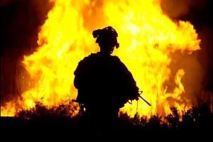 Image Source: The U.S. Army, Flickr, Creative Commons www.Army.mil U.S. Army Sgt. William Reese watches flames rise into the night sky after setting canal vegetation ablaze in Tahwilla, Iraq, July 30, 2008. Extremists have been using the canal's thick vegetation to plant bombs under the cover of darkness. The soldiers are assigned to Company B, 1st Battalion, 6th Infantry Regiment.U.S. Army photo by Spc. David J. Marshall