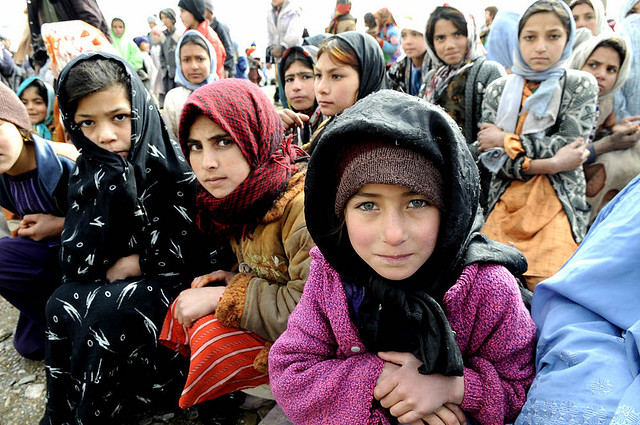 Image Source: ResoluteSupportMedia, Flickr, Creative Commons 090204-F-6426S-102  GOZARAH, Afghanistan-Village girls wait as the Afghan National Police unload a shipment of humanitarian aid at their village, Feb. 4. Food, winter clothing and supplies were delivered to 300 villagers of Gozarah district in Herat province of western Afghanistan. (ISAF photo by U.S. Air Force TSgt Laura K. Smith)(released) .