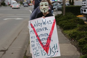 Photo credit: Oregon III% An Anonymous member holding a sign at the unified rally in Oregon.