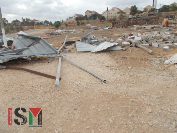 The two demolished structures – with the illegal settlement in the background
